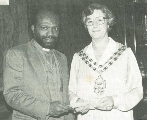Ashton Gibson receiving a cheque in 1984 from the Police Property Act Fund via Hackney Mayoress Bella Callaghan